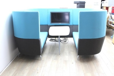 Blue Orangebox meeting sofa with table and tv
