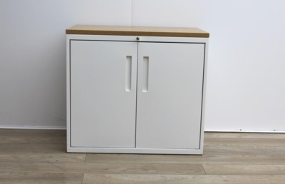 White metal cupboard with walnut top